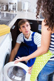 Specialist in uniform consulting housewife Stock Photography