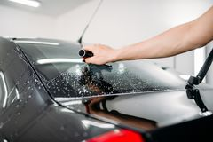 Specialist work, car tinting film installation Stock Images