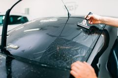 Specialist work, car tinting film installation stock photos