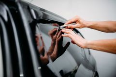 Specialist work with car, tinting film installing Stock Photo