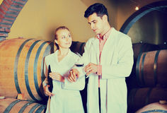 Specialists  checking ageing process of wine Stock Photo