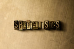 SPECIALISTS - close-up of grungy vintage typeset word on metal backdrop. Royalty free stock illustration.  Can be used for online banner ads and direct mail Royalty Free Stock Photography