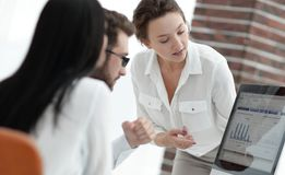 Specialists of the company discussing financial schedules at the desk. Accounting Stock Photos