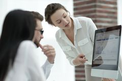 Specialists of the company discussing financial schedules at the desk Royalty Free Stock Images