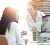 Specialists of the company discussing financial schedules at the. Desk. accounting Stock Photos