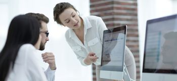 Specialists of the company discussing financial schedules at the desk. Accounting Stock Photo