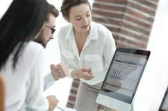 Specialists of the company discussing financial schedules at the desk. Accounting Stock Image