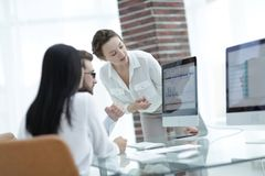 Specialists of the company discussing financial schedules at the desk. Accounting Stock Photography