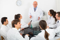Specialists  having discussion Stock Images