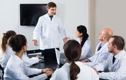 Specialists  having discussion Stock Photos