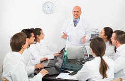 Specialists  having discussion Royalty Free Stock Photos