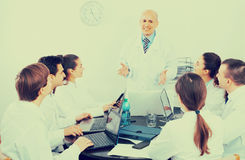 Specialists  having discussion Royalty Free Stock Image