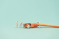 Specialists with network cable. Macro photo Stock Images