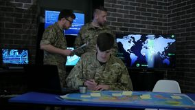 IT specialists, working process, group people, on military stock video footage