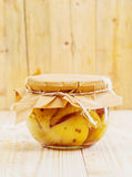 Speciality confection of preserved pears and vanilla. Speciality gourmet confection of preserved pears and vanilla tied off with a piece of rustic brown paper Stock Image