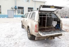 Specialized car for transportation of dogs during a sled dog rac. Samara, Russia - January 6, 2018: Specialized car for transportation of dogs during a sled dog Royalty Free Stock Photography