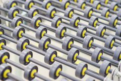 Specialized conveyor line for the production of medical products consisting of many small rollers close-up. Abstract background. Modern technologies Stock Photography