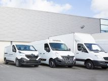 Delivery society parking with small trucks and van. Specialized delivery society parking with small trucks and van royalty free stock images