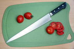 Specialized fillet knife for processing of products. Specialized fillet knife for thin cutting of products on a chopping board Royalty Free Stock Photos