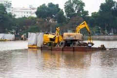 Specialized floating excavator cleans marine sediments of lake bottom.  Stock Image