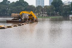 Specialized floating excavator cleans marine sediments of lake bottom.  royalty free stock images