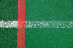A specialized outdoor sports ground covering a rubber crumb of green color with marked lines for playing sports. A close-up is a specialized outdoor sports Royalty Free Stock Photos