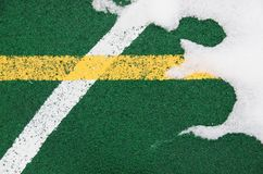 A specialized outdoor sports ground covering a rubber crumb of green color with marked lines for playing sports. Covered. A close-up is a specialized outdoor Royalty Free Stock Photos
