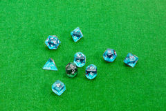 Specialized polyhedral dice for role-playing games on green clot Stock Photos