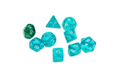 Specialized polyhedral dice for role-playing games. Set of blue and green specialized polyhedral dice with numbers used in role-playing games on a light royalty free stock photos