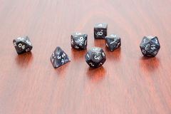Specialized polyhedral dice for role-playing games on wooden sur Stock Image
