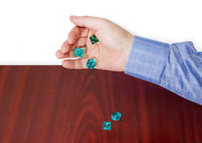 Specialized polyhedral dice thrown from male hand on wooden surf Royalty Free Stock Photos