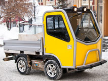 Specialized utility vehicule. For ski village going up hill in snow Royalty Free Stock Photos