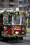 Specially decorated Christmas tram ride. VIENNA, AUSTRIA - DECEMBER 11: Specially decorated Christmas tram ride through the streets of Vienna on the joy of Royalty Free Stock Images
