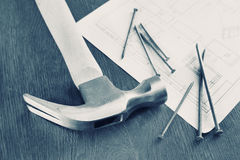 Specially toned image with hammer and nails on a table Stock Images