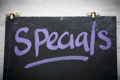 Specials on blackboard. Handwritten sign outside cafe advertising specials on the menu for the day Royalty Free Stock Photos