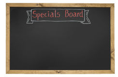 Specials board. With chalk writing, wood frame and white background as used in cafe or restaurant Royalty Free Stock Image