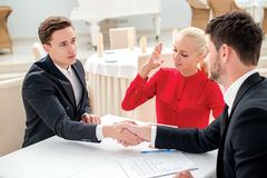 Specials. Three successful and confident businesspeople shake ha Stock Photos