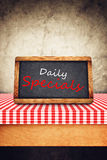 Daily Specials Title on Restaurant Slate Chalkboard. Daily Specials Title in white chalk on Restaurant Blackboard. Food and Nutrition background Royalty Free Stock Photos