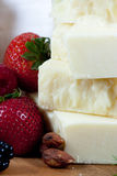 Specialty cheese. Berries and almonds Royalty Free Stock Images