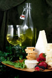 Specialty cheese. With berries and wine Royalty Free Stock Photography