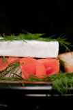 Specialty cheese. Brie cake with salmon Royalty Free Stock Photos