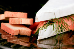 Specialty cheese. Brie cake with salmon Stock Image