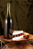 Specialty cheese. Brie cake with berries and wine Stock Photography
