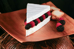 Specialty cheese. Brie cake with berries and toast Stock Photos