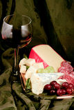Specialty cheese. With salami and grapes Stock Photos