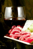 Specialty cheese. With salami and grapes Royalty Free Stock Photography