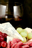 Specialty cheese. With salami and grapes Stock Photo