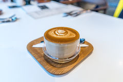 Specialty coffee latte with latter art in flower Royalty Free Stock Photo