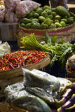 Species and spices. Species Market in Jimbaran Bali. Chili spices, pepper and other vegetables in baskets and bags Stock Photos
