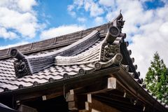 Specific carvings on a traditional Japanese roof in Kyoto. Roof detail of one of the traditional buildings with specific carvings at Kiyomizu-dera buddhist royalty free stock images
